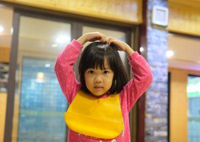 Hailey doing the Korean love sign.